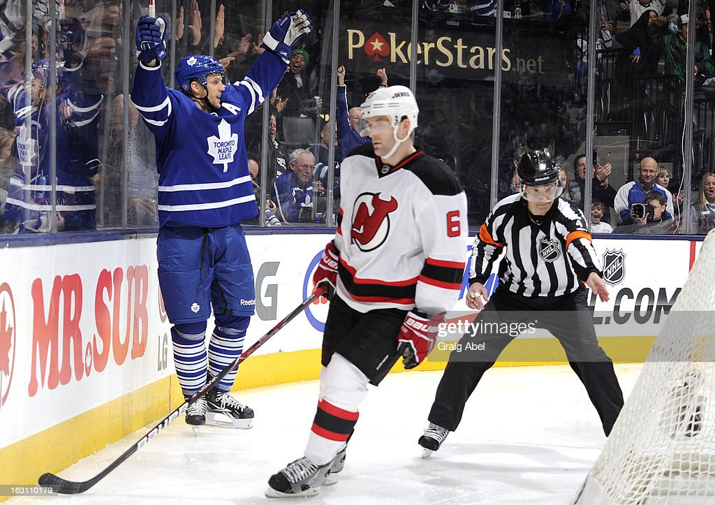 <a gi-track='captionPersonalityLinkClicked' href=/galleries/search?phrase=Jay+McClement&family=editorial&specificpeople=575233 ng-click='$event.stopPropagation()'>Jay McClement</a> #11 of the Toronto Maple Leafs celebrates a third period goal as <a gi-track='captionPersonalityLinkClicked' href=/galleries/search?phrase=Andy+Greene&family=editorial&specificpeople=3568726 ng-click='$event.stopPropagation()'>Andy Greene</a> #6 of the New Jersey Devils skates past with referee Wes McCauley points to the net during NHL game action March 4, 2013 at the Air Canada Centre in Toronto, Ontario, Canada.