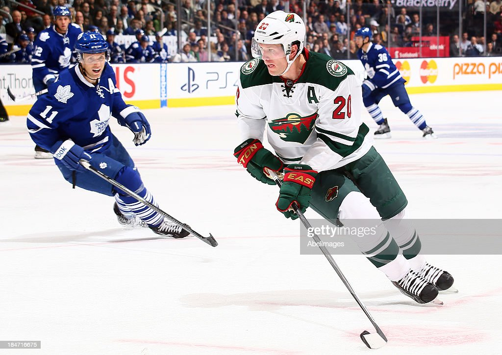 <a gi-track='captionPersonalityLinkClicked' href=/galleries/search?phrase=Jay+McClement&family=editorial&specificpeople=575233 ng-click='$event.stopPropagation()'>Jay McClement</a> #11 of the Toronto Maple Leafs chases down <a gi-track='captionPersonalityLinkClicked' href=/galleries/search?phrase=Ryan+Suter&family=editorial&specificpeople=583306 ng-click='$event.stopPropagation()'>Ryan Suter</a> #20 of the Minnesota Wild during NHL action at the Air Canada Centre October 15, 2013 in Toronto, Ontario, Canada.