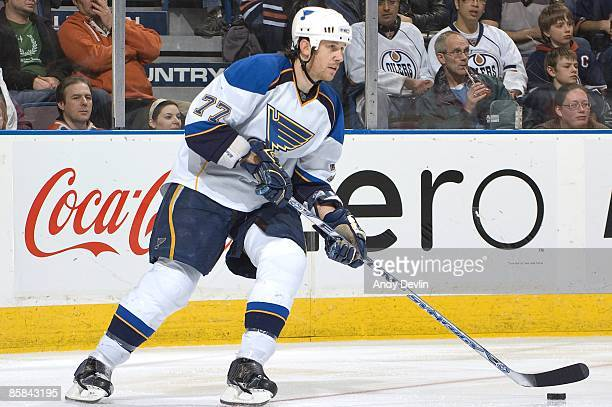 Jay McKee of the St Louis Blues carries the puck against the Edmonton Oilers at Rexall Place on March 17 2009 in Edmonton Alberta Canada The Oilers...