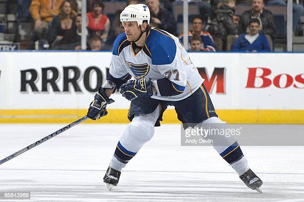 Jay McKee of the St Louis Blues defends against the Edmonton Oilers at Rexall Place on March 17 2009 in Edmonton Alberta Canada The Oilers beat the...