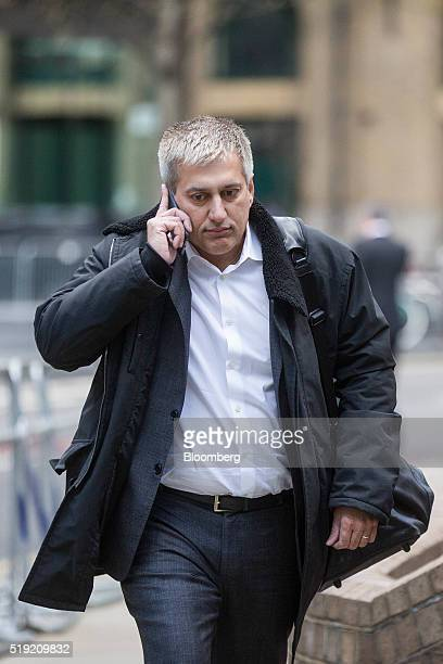 Jay Merchant a former trader at Barclays Plc listens to his mobile phone as he arrives at Southwark Crown Court in London UK on Tuesday April 5 2016...