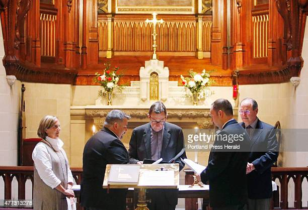 Jay Norris and Doug Fillmore of Portland joined by their first Portland friends Pam and Fred Caswell as witnesses say their vows with Rev Richard...