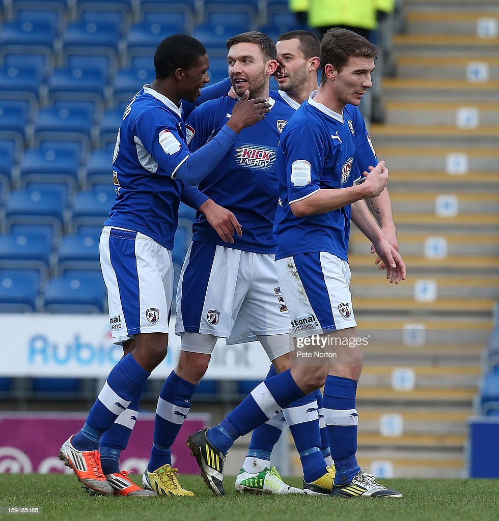 Jay O'Shea of Chesterfield is congratulated by team mates after scoring his sides 1st goal during the npower League Two match between Chesterfield and Northampton Town at the Proact Srtadium on January 12, 2013 in Chesterfield, England.