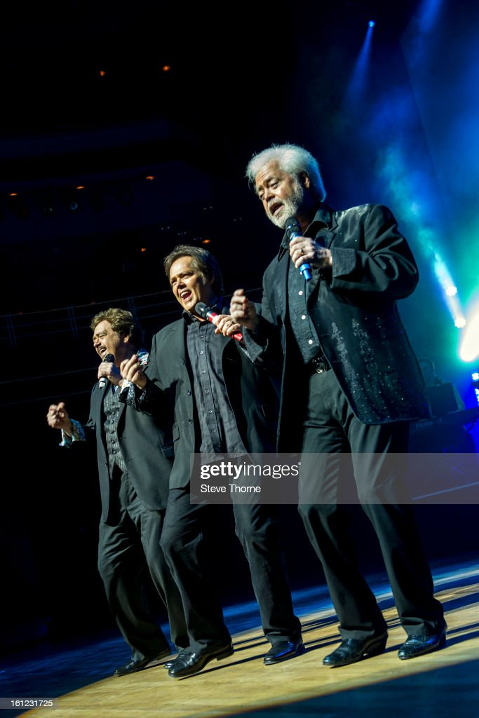 Jay Osmond, <a gi-track='captionPersonalityLinkClicked' href=/galleries/search?phrase=Jimmy+Osmond&family=editorial&specificpeople=836992 ng-click='$event.stopPropagation()'>Jimmy Osmond</a> and Merrill Osmond perform on stage as part of Boogie Nights at Symphony Hall on February 9, 2013 in Birmingham, England.