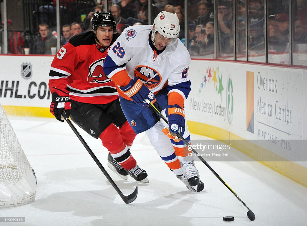 <a gi-track='captionPersonalityLinkClicked' href=/galleries/search?phrase=Jay+Pandolfo&family=editorial&specificpeople=202871 ng-click='$event.stopPropagation()'>Jay Pandolfo</a> #29 of the New York Islanders controls the puck against <a gi-track='captionPersonalityLinkClicked' href=/galleries/search?phrase=Zach+Parise&family=editorial&specificpeople=213606 ng-click='$event.stopPropagation()'>Zach Parise</a> #9 of the New Jersey Devils during the third period on March 8, 2012 at the Prudential Center in Newark, New Jersey.