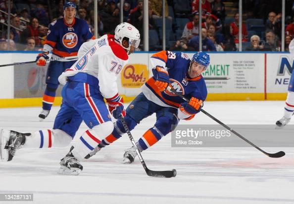 Jay Pandolfo of the New York Islanders skates against PK Subban of the Montreal Canadiens at Nassau Veterans Memorial Coliseum on November 17 2011 in...