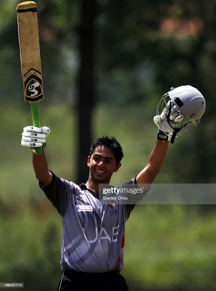 Jay Pankesh Joshi of UAE celebrates after he score a century against Nepal during the ACC U-19 Elite Cup Semi Final match between UAE and Nepal at the Bayuemas Oval on May 10, 2013 in Kuala Lumpur, Malaysia.