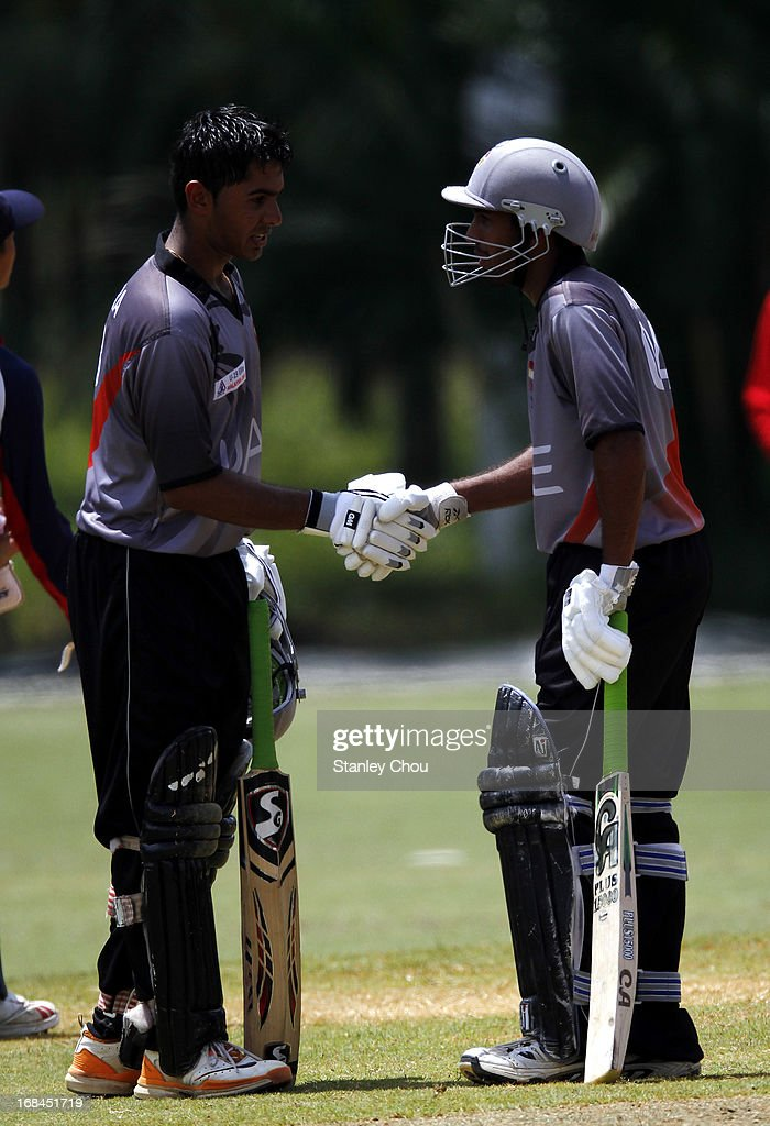 Jay Pankesh Joshi (L) of UAE is congratulated by his team-mate Zamin Jaleel after he score a century against Nepal during the ACC U-19 Elite Cup Semi Final match between UAE and Nepal at the Bayuemas Oval on May 10, 2013 in Kuala Lumpur, Malaysia.