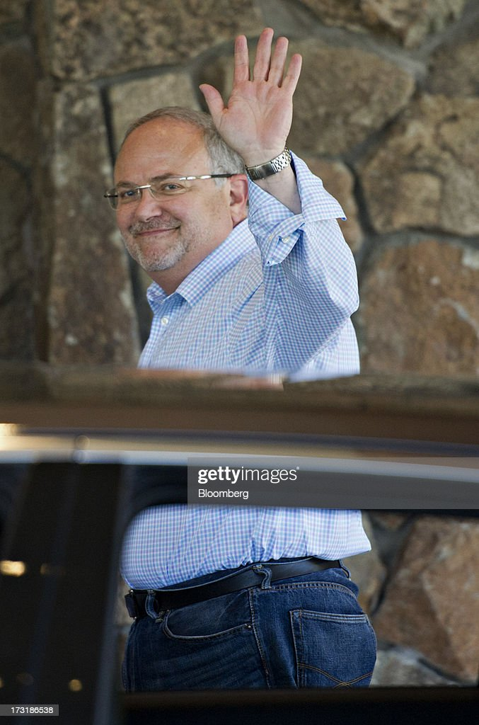 Jay Rasulo, chief financial officer of The Walt Disney Co., waves while arriving at the Allen & Co. Media and Technology Conference in Sun Valley, Idaho, U.S., on Tuesday, July 9, 2013. Media dealmakers digesting $53 billion of mergers, spinoffs and acquisitions announced so far this year, head to Allen & Co.s Sun Valley conference this week to lay the groundwork for more. Photographer: Daniel Acker/Bloomberg via Getty Images