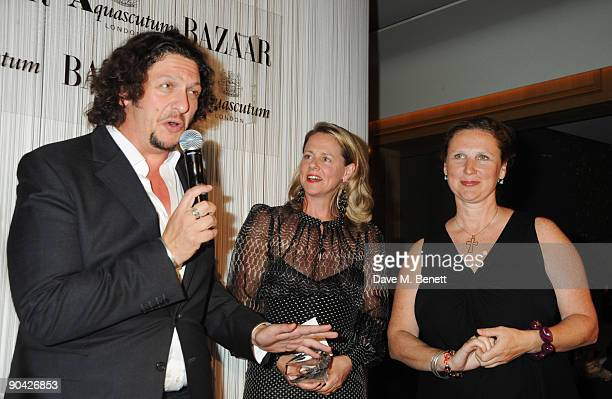 Jay Rayner Angela Hartnett and guest attend the Harper's Bazaar Women Of The Year Awards at The Dorchester on September 7 2009 in London England
