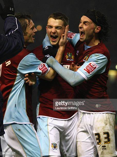 Jay Rodriguez of Burnley celebrates scoring his team's third goal with team mates Graham Alexander and Chris Eagles during the Carling Cup Semi Final...