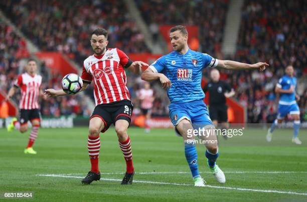 Jay Rodriguez of Southampton and Simon Francis of AFC Bournemouth battle for possession during the Premier League match between Southampton and AFC...