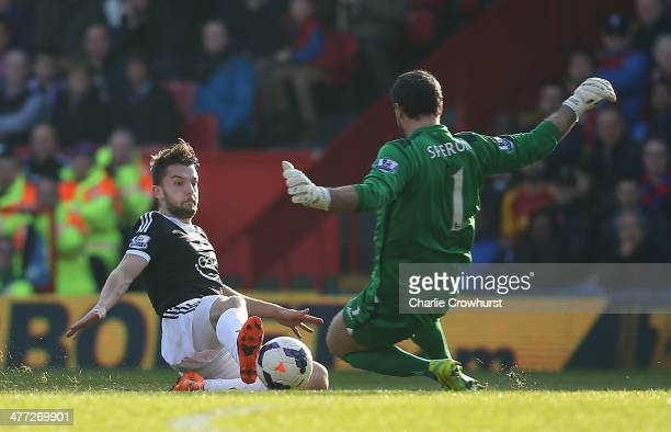 Jay Rodriguez of Southampton beats Palace keeper Julian Speroni to the ball to score the first goal of the game during the Barclays Premier League...
