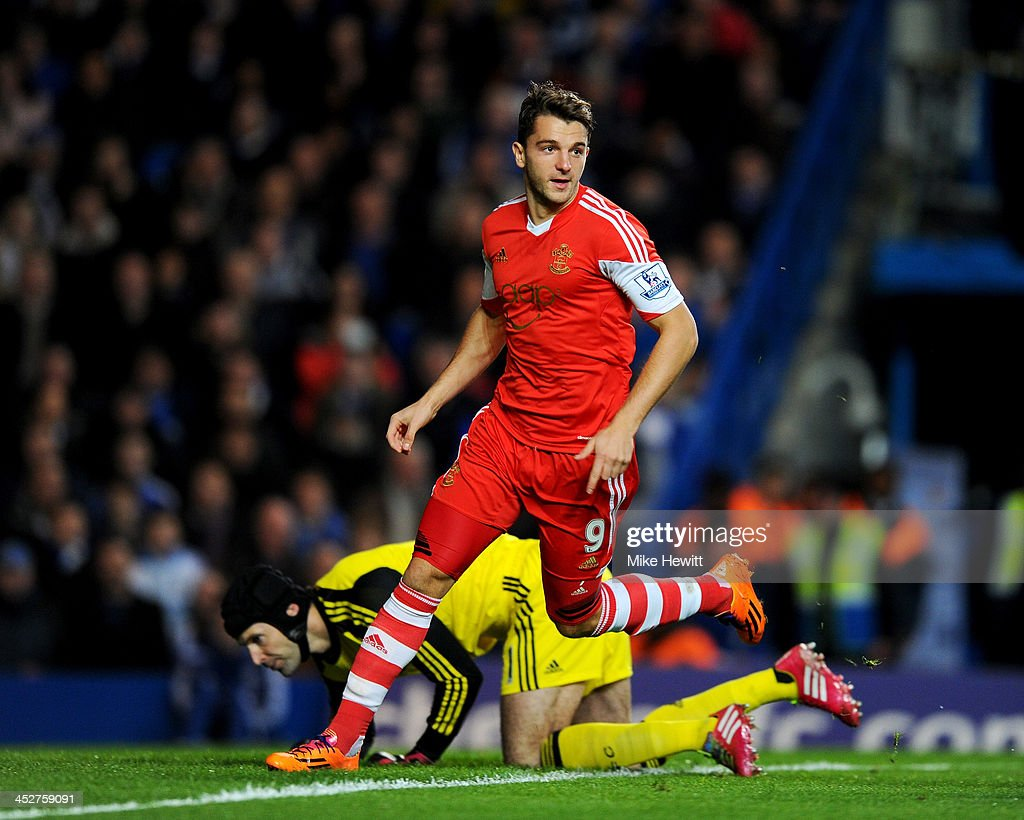 Jay Rodriguez of Southampton celebrates as he scores their first goal in the first minute as Petr Cech of Chelsea looks on during the Barclays...