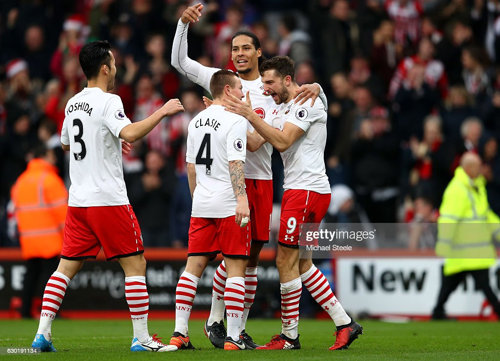 Jay Rodriguez of Southampton (R) celebrates scoring his sides second goal with Jordy Clasie of Southampton (C), Virgil van Dijk of Southampton (C) and Maya Yoshida of Southampton (L) during the Premier League match between AFC Bournemouth and Southampton at Vitality Stadium on December 18, 2016 in Bournemouth, England.
