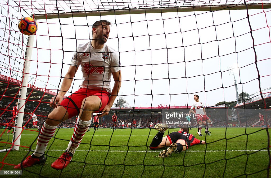 Jay Rodriguez of Southampton (L) celebrates scoring his sides second goal during the Premier League match between AFC Bournemouth and Southampton at Vitality Stadium on December 18, 2016 in Bournemouth, England.