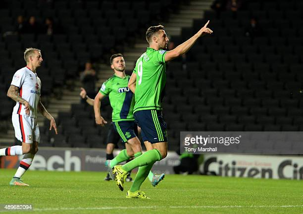 Jay Rodriguez of Southampton celebrates scoring their fourth goal from the penalty spot during the Capital One Cup third round match between MK Dons...