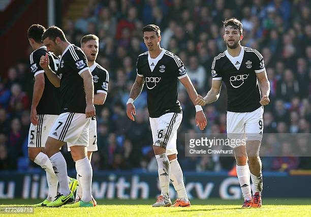 Jay Rodriguez of Southampton celebrates with team mates after scoring the first goal of the game during the Barclays Premier League match between...