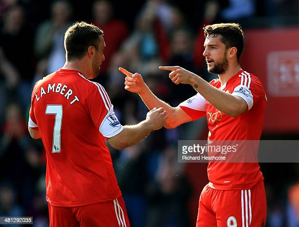 Jay Rodriguez of Southampton celebrates with teammate Rickie Lambert after scoring the opening goal during the Barclays Premier League match between...