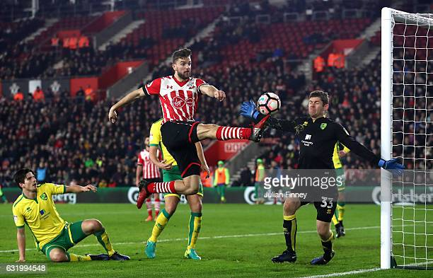 Jay Rodriguez of Southampton challenges for the ball with Michael McGovern of Norwich City during The Emirates FA Cup Third Round Replay match...