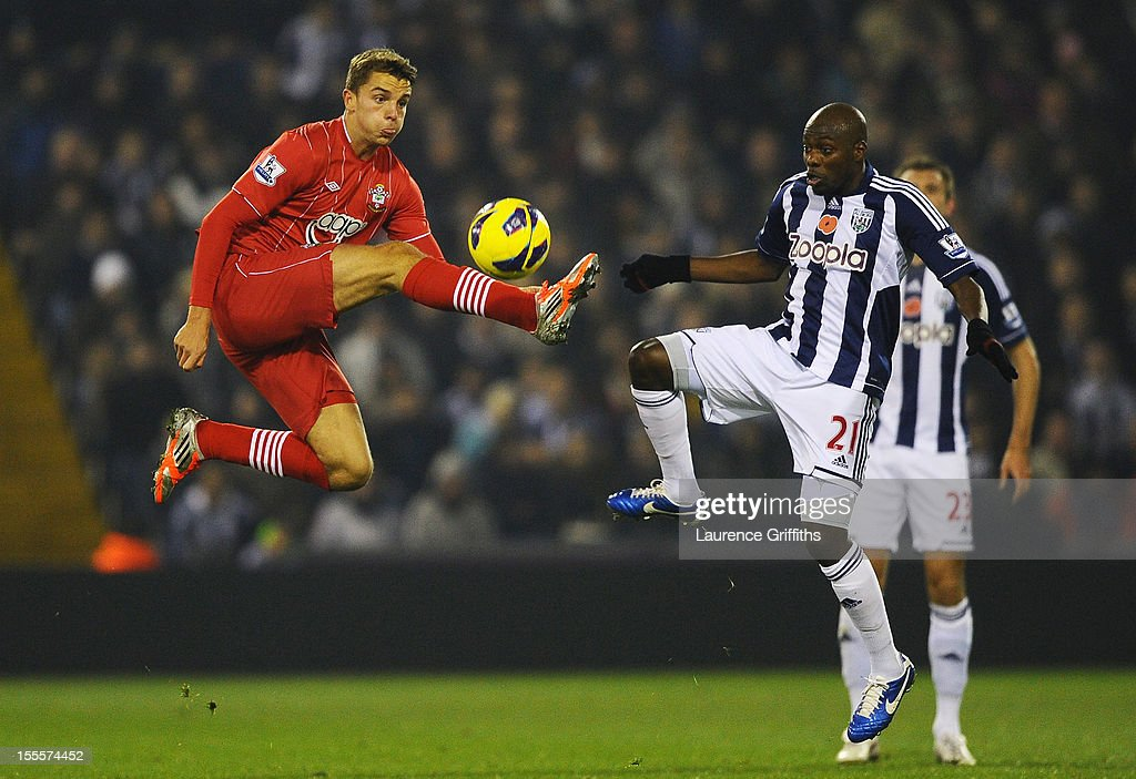 Jay Rodriguez of Southampton competes with Youssuf Mulumbu of West Bromwich Albion during the Barclays Premier League match between West Bromwich Albion and Southampton at The Hawthorns on November 5, 2012 in West Bromwich, England.