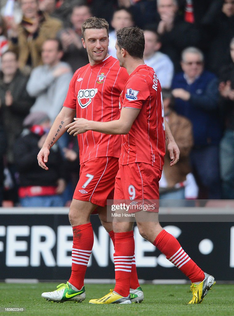 Jay Rodriguez of Southampton (R) congratulates goalscorer Rickie Lambert during the Barclays Premier League match between Southampton and Liverpool at St Mary's Stadium on March 16, 2013 in Southampton, England.