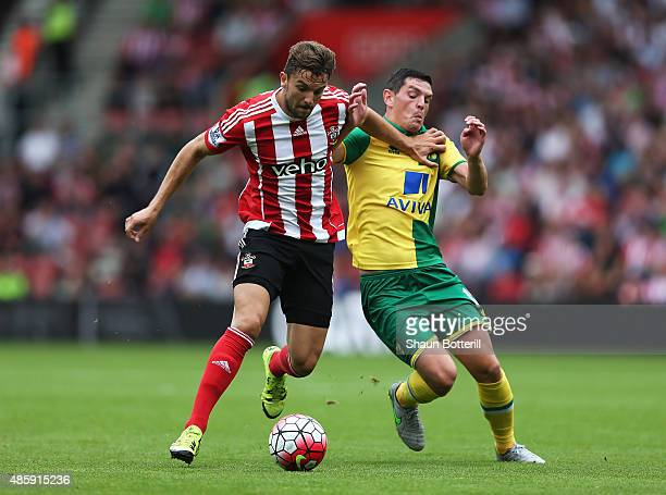 Jay Rodriguez of Southampton is challenged by Graham Dorrans of Norwich City during the Barclays Premier League match between Southampton and Norwich...
