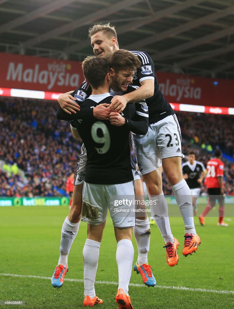 Jay Rodriguez of Southampton is congratulated by <a gi-track='captionPersonalityLinkClicked' href=/galleries/search?phrase=Adam+Lallana&family=editorial&specificpeople=5475862 ng-click='$event.stopPropagation()'>Adam Lallana</a> and <a gi-track='captionPersonalityLinkClicked' href=/galleries/search?phrase=Luke+Shaw&family=editorial&specificpeople=7601993 ng-click='$event.stopPropagation()'>Luke Shaw</a> after his opening goal during the Barclays Premier League match between Cardiff City and Southampton at Cardiff City Stadium on December 26, 2013 in Cardiff, Wales.