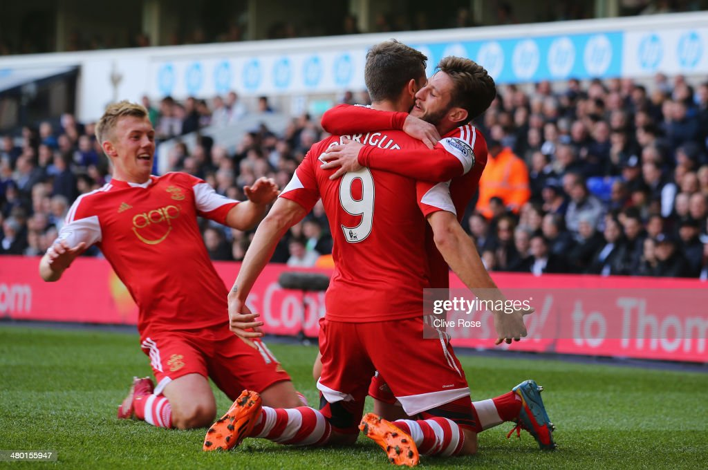 Jay Rodriguez of Southampton is congratulated by <a gi-track='captionPersonalityLinkClicked' href=/galleries/search?phrase=Adam+Lallana&family=editorial&specificpeople=5475862 ng-click='$event.stopPropagation()'>Adam Lallana</a> of Southampton after scoring the opening goal during the Barclays Premier League match between Tottenham Hotspur and Southampton at White Hart Lane on March 23, 2014 in London, England.