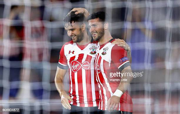 Jay Rodriguez of Southampton is congratulated by Shane Long after scoring their third during the UEFA Europa League Group K match between Southampton...