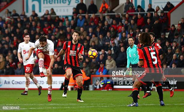 Jay Rodriguez of Southampton scores his sides third goal during the Premier League match between AFC Bournemouth and Southampton at Vitality Stadium...