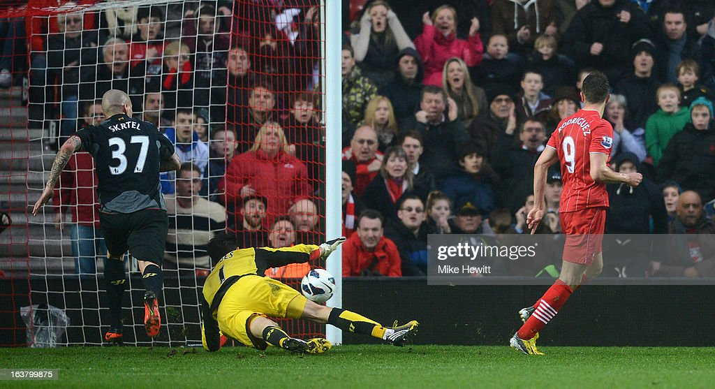 Jay Rodriguez of Southampton scores his team's 3rd goal despite the efforts of goalkeeper <a gi-track='captionPersonalityLinkClicked' href=/galleries/search?phrase=Brad+Jones+-+Soccer+Player&family=editorial&specificpeople=643165 ng-click='$event.stopPropagation()'>Brad Jones</a> of Liverpool during the Barclays Premier League match between Southampton and Liverpool at St Mary's Stadium on March 16, 2013 in Southampton, England.