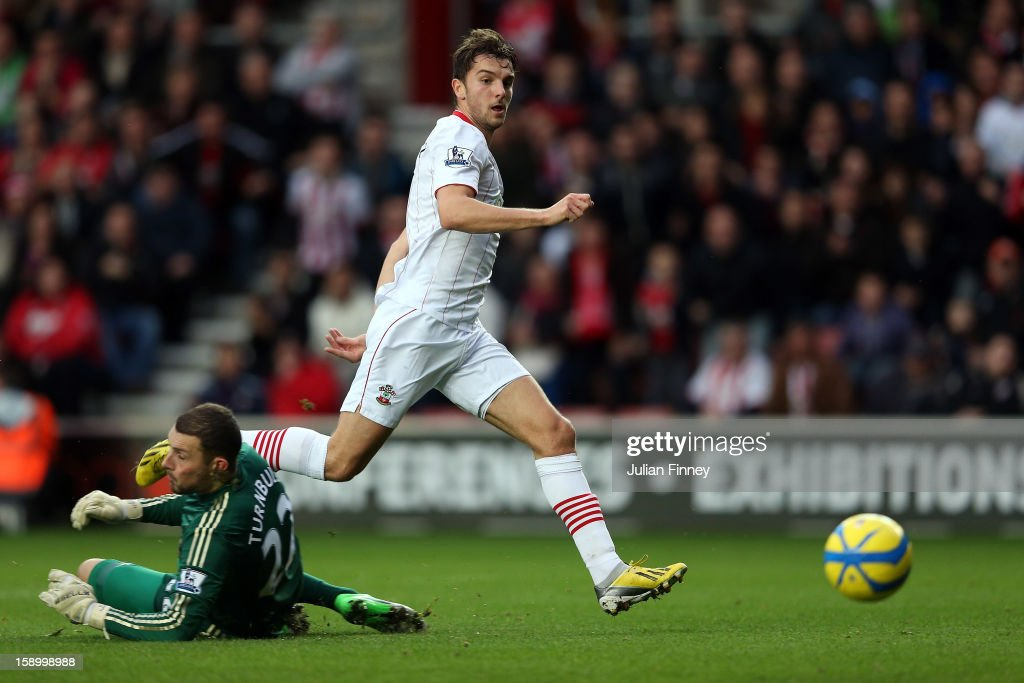 Jay Rodriguez of Southampton scores the first goal past <a gi-track='captionPersonalityLinkClicked' href=/galleries/search?phrase=Ross+Turnbull+-+Soccer+Player&family=editorial&specificpeople=653834 ng-click='$event.stopPropagation()'>Ross Turnbull</a> of Chelsea during the FA Cup Third Round match between Southampton and Chelsea at St Mary's Stadium on January 5, 2013 in Southampton, England.