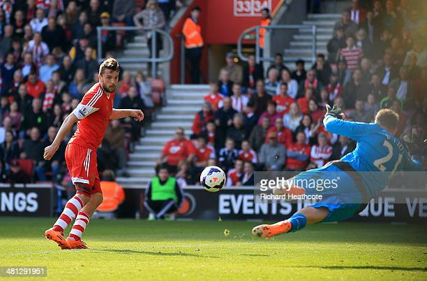 Jay Rodriguez of Southampton scores the opening goal past goalkeeper Robert Elliot of Newcastle United during the Barclays Premier League match...