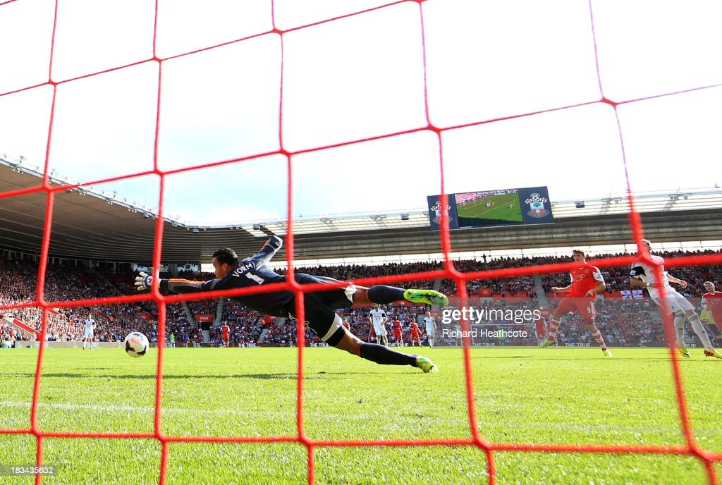 Jay Rodriguez of Southampton (2R) shoots past goalkeeper <a gi-track='captionPersonalityLinkClicked' href=/galleries/search?phrase=Michel+Vorm&family=editorial&specificpeople=6243381 ng-click='$event.stopPropagation()'>Michel Vorm</a> of Swansea City to score their second goal during the Barclays Premier League match between Southampton and Swansea City at St Mary's Stadium on October 6, 2013 in Southampton, England.