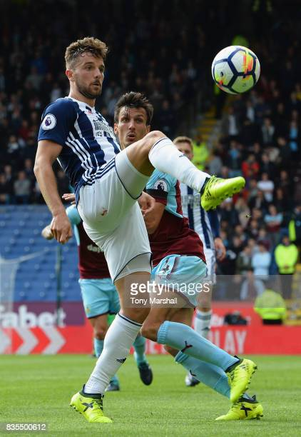 Jay Rodriguez of West Bromwich Albion and Jack Cork of Burnley battle for possession during the Premier League match between Burnley and West...