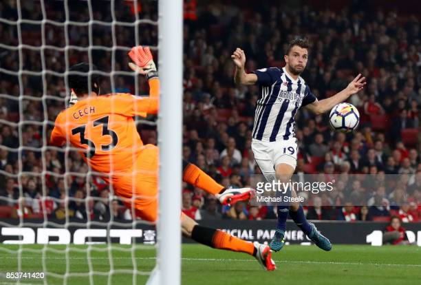 Jay Rodriguez of West Bromwich Albion shoots past Petr Cech of Arsenal during the Premier League match between Arsenal and West Bromwich Albion at...