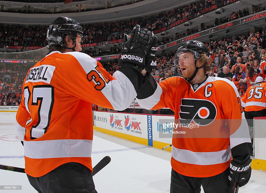 Jay Rosehill and Claude Giroux of the Philadelphia Flyers celebrate after defeating the New York Islanders 64 on January 18 2014 at the Wells Fargo...