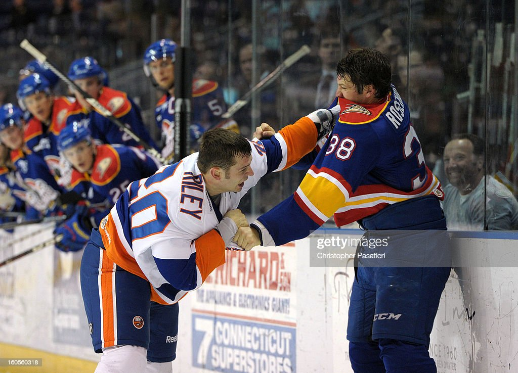 Jay Rosehill #38 of the Norfolk Admirals and Blair Riley #20 of the Bridgeport Sound Tigers fight during an American Hockey League game on February 2, 2013 at the Webster Bank Arena at Harbor Yard in Bridgeport, Connecticut.