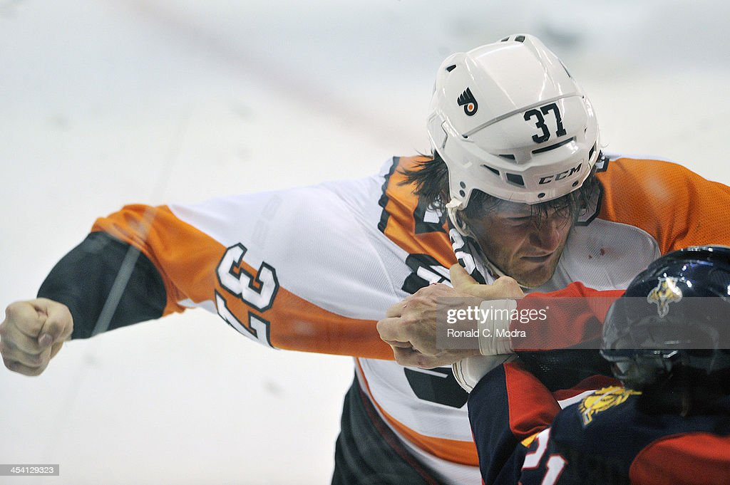 Jay Rosehill of the Philadelphia Flyers and Krys Barch of the Florida Panthers fight during during a NHL game at the BBT Center on November 25 2013...