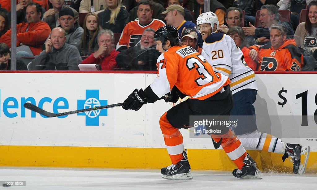 Jay Rosehill of the Philadelphia Flyers battles for the puck against Henrik Tallinder of the Buffalo Sabres on November 21 2013 at the Wells Fargo...