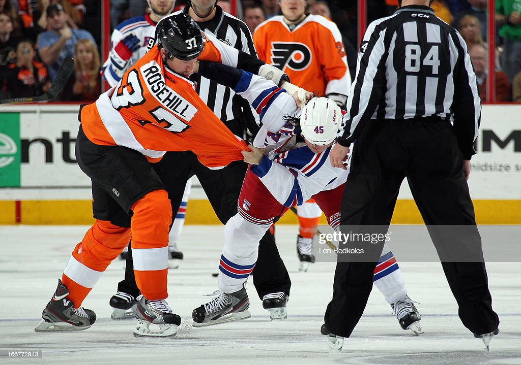 Jay Rosehill #37 of the Philadelphia Flyers fights <a gi-track='captionPersonalityLinkClicked' href=/galleries/search?phrase=Arron+Asham&family=editorial&specificpeople=203158 ng-click='$event.stopPropagation()'>Arron Asham</a> #45 of the New York Rangers in the second period on April 16, 2013 at the Wells Fargo Center in Philadelphia, Pennsylvania.