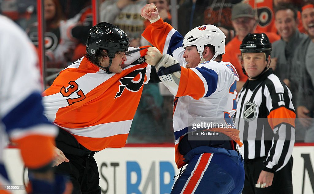 Jay Rosehill of the Philadelphia Flyers fights Eric Boulton of the New York Islanders in the first period on January 18 2014 at the Wells Fargo...