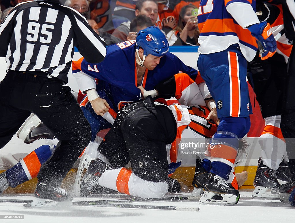 Jay Rosehill of the Philadelphia Flyers fights with Matt Carkner of the New York Islanders at the Nassau Veterans Memorial Coliseum on January 20...