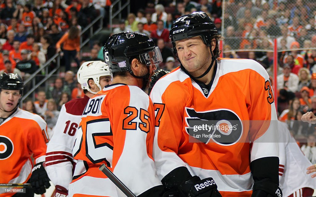 Jay Rosehill of the Philadelphia Flyers grimaces during a stoppage in play against the Phoenix Coyotes on October 11 2013 at the Wells Fargo Center...