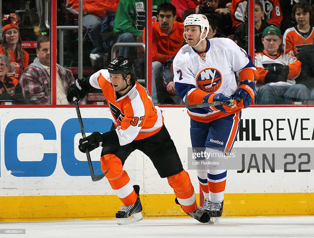 Jay Rosehill of the Philadelphia Flyers skates against Matt Carkner of the New York Islanders on January 18 2014 at the Wells Fargo Center in...