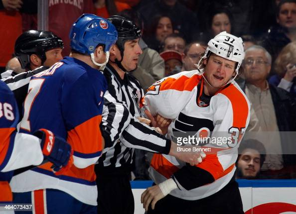 Jay Rosehill of the Philadelphia Flyers skates to the penalty box after his first period fight with Matt Carkner of the New York Islanders at the...