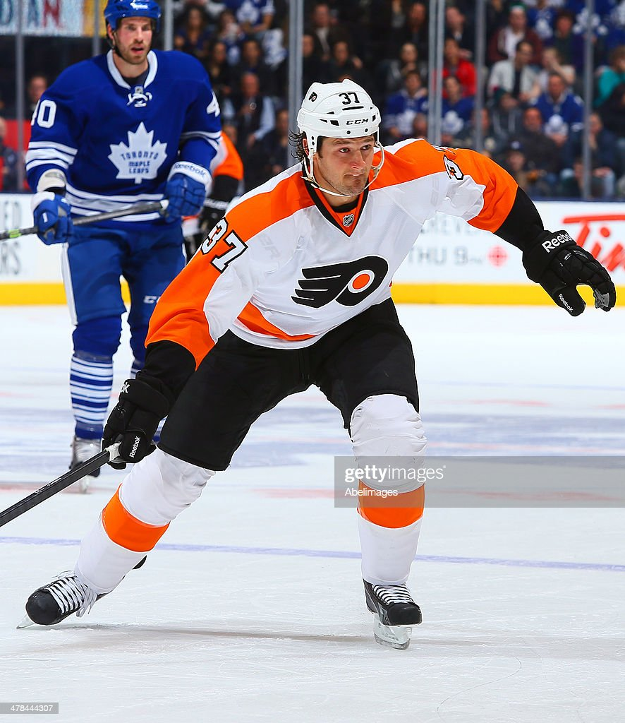 Jay Rosehill of the Philadelphia Flyers skates up the ice during NHL action against the Toronto Maple Leafs at the Air Canada Centre March 8 2014 in...