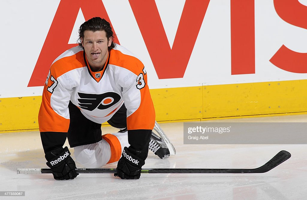 Jay Rosehill #37 of the Philadelphia Flyers stretches during warm up prior to NHL game action against the Toronto Maple Leafs March 8, 2014 at the Air Canada Centre in Toronto, Ontario, Canada.