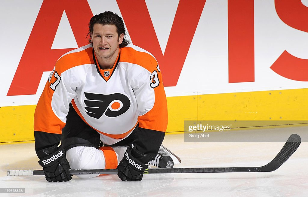 Jay Rosehill of the Philadelphia Flyers stretches during warm up prior to NHL game action against the Toronto Maple Leafs March 8 2014 at the Air...